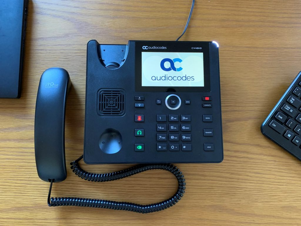 AudioCodes C448 review showing a picture of the phone during startup.